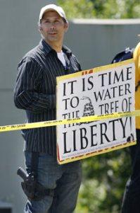 Protester with gun